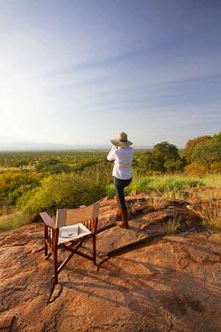 KEN9400 Kenya, Meru National Park. A young lady looks out over Meru National Park.