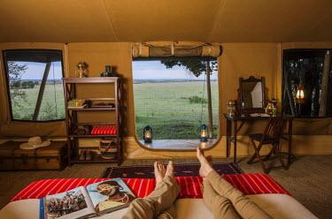 KEN9484 Kenya, Mara North Conservancy. The interior of a luxury safari tent in Elephant Pepper Camp. MR.