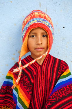 HMS0449960 Peru, Cuzco Province, Sacred Valley of the Incas, Ollantaytambo, young Peruvian with his poncho and llama cap