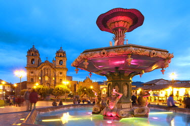 Peru, Cuzco Province, Cuzco, listed as World Heritage by UNESCO, Plaza de Armas, iluminated foutain and La Compania de Jesus church, built in 1650 on the site of an Inca palace, it has a Baroque facad...