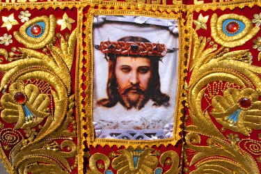 HMS0886450 Peru, Cuzco Province, Cuzco, listed as World Heritage by UNESCO, embroidered cloth representing the Christ of Torechayoc with eyes closed