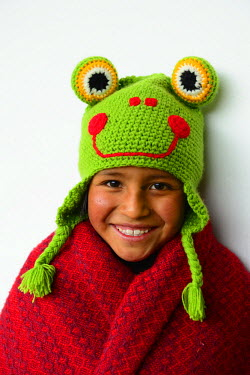 HMS1880812 Peru, Cuzco province, Cuzco, listed as World Heritage by UNESCO, Nohemi Huanacchire, young girl of the Ninos Unidos Peruanos Charitable Foundation wearing an alpaca wool bonnet