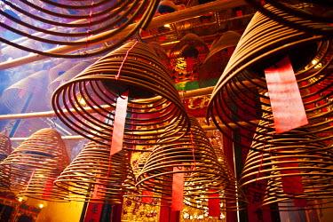 AS09TEG0049 China, Hong Kong, Spiral Incense sticks at Man Mo Temple or Man Mo Miu is a Cantonese transliteration of Wen Wu temple
