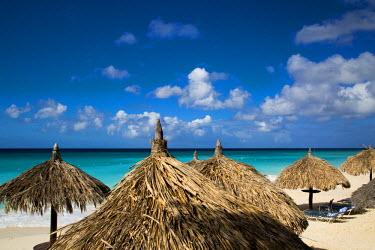 CA04BJN0006 Grass umbrellas along the white sandy beach at Eagle Beach, Aruba, West Indies
