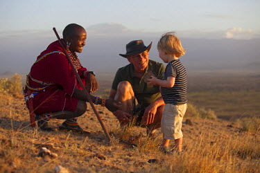 KEN9714 Kenya, Amboseli, Tortilis Camp. A boy and his grandfather learn about the wilderness from their Masai guide. MR.