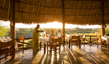 KEN9732 Kenya, Amboseli, Tortilis Camp. The dining room at Tortilis in the evening light. MR.