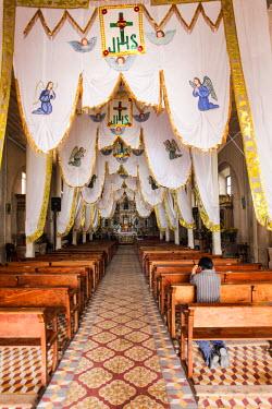 SA10JMR0094 Interior of a local church, Santa Maria de Jesus, Guatemala.