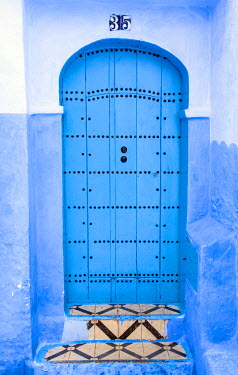 MOR2214AW Blue-washed streets and doors of Chefchaouen, Morocco