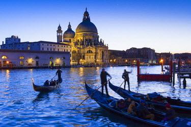 ITA4237AW Gondolas and Santa Maria della Salute at dusk. Venice, Veneto, Italy
