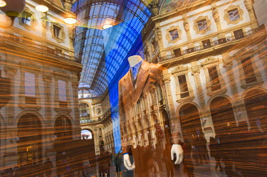 ITA4266AW Reflections in the window of Prada's shop in the center of Vittorio Emanuele's Gallery, Milan, Italy