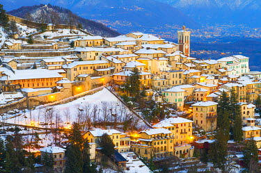 ITA4270AW The Unesco heritage holy mount (sacromonte) of Varese covered with snow at dusk, Varese, Italy