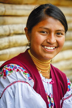 HMS2104023 Ecuador, Imbabura, Chilcapamba, portrait of a young peasant girl dressed Ecuadorian traditional way