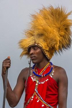 KEN9761AW Africa, Kenya, Masai Mara National Reserve. Masai warrier wearing lion mane headress