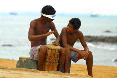 HMS2099013 Brazil, Bahia state, Salvador de Bahia, two young percussionists on Farol beach Bara