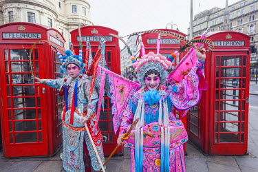 TPX49477 England, London, Soho, Chinatown, Chinese New Year Festival Parade, Couple Dressed in Chinese Opera Costume and Telephone Boxes