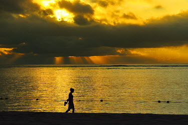 MTS0007AW Woman walks along Le Morne beach, Mauritius, Indian Ocean, MR