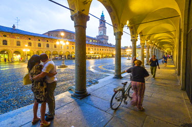 ITA4299AW Piazza Ducale, Vigevano, Lombardy,  Italy. Rainy sunset and people.