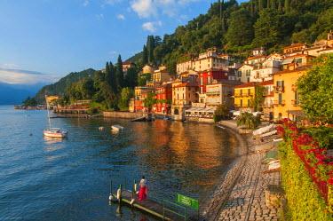 ITA4315AW Varenna, Como lake, Lombardy, Italy. Woman on the pier.