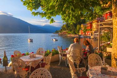 ITA4316AW Varenna, Como lake, Lombardy, Italy. Tourists at the restaurant at sunset.