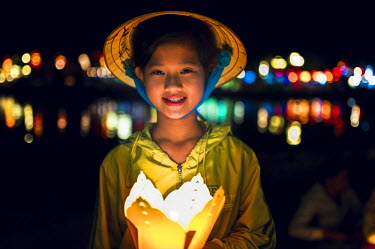 VIT0955AW Hoi An, Vietnam. Selling lanterns on the street at night.