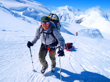 ARBOME000023 Mountain ranger Brian Scheele on this way to Windy Corner on Mount McKinley, also know as Denali, in Alaska. He is pulling a sled, that together with his heavy backpack is containing all the gear like...