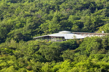 CR33020AW Central America, Costa Rica, Guanacaste, Bagaces, Rio Perdido resort, the main resort building surrounded by forest