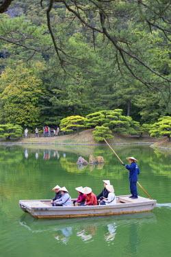 JAP0882AW Tourists on boat in Ritsurin-koen, Takamatsu, Shikoku, Japan