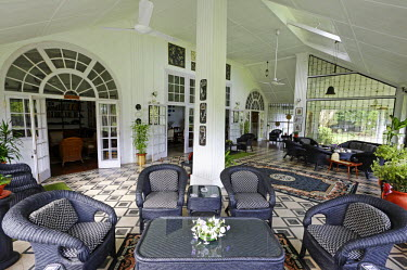 IND7888 India, Assam, Balipara, Addabarie Tea Estate. The main verandah of Wild Mahseer's 'Heritage Bungalow' which was originally the residence of the tea estate's so-called visiting agent. The bungalow now...
