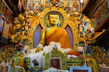 IND7891 India, Arunachal Pradesh, Tawang. An imposing statue of the Buddha dominates the 'Dukhang', or main prayer hall, of 17th-century Tawang Monastery which stands near neighbouring Bhutan and Tibet.