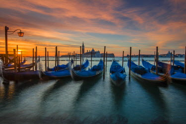 ITA4456AW Moored gondolas at sunrise with San Giorgio Maggiore island in the background, Venice, Veneto, Italy