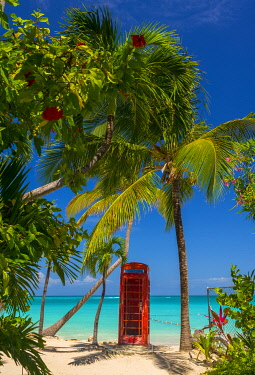AB01127 Caribbean, Antigua, Dickinson Bay, Dickinson Bay Beach, Red British Telephone Box