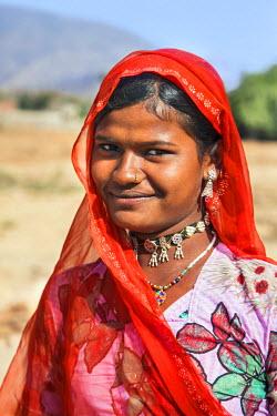 IND7800 India, Jaysamand, Rajasthan.  A Rajasthani woman wearing bright clothing.
