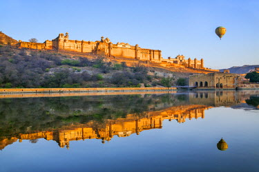IND7829 India, Rajasthan, Jaipur, Amer.  The magnificent 16th century Amber Fort at sunrise with a hot air balloon aloft.