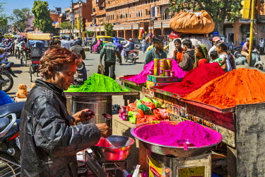 IND7869 India, Rajasthan, Jaipur.  Coloured powders for the annual Hindu religious festival of Holi being sold from a mobile stall in the busy market area of old Jaipur.