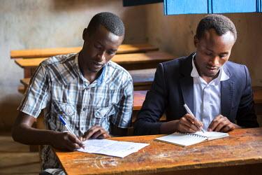 ARCUJU000086 Students work on applications to a university at the Kiziba Refugee Camp in Kibuye, Rwanda.