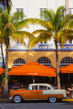 US11818 U.S.A, Miami, Miami Beach, South Beach, Ocean Drive, Orange and white Chevrolet car parked outside Ocean's Ten restaurant