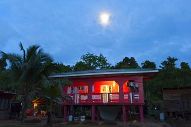 HMS2104828 France, French Guiana, Parc Amazonien de Guyane (Guiana Amazonian Park), Providence, stilted house at dusk