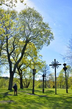 SWE4295AW Lithuanian crosses of the Etnografiska museet in the tranquility of Djurgardsbrunn, a part of Djurgarden, one of the biggest green parks of Stockholm. Sweden (MR)