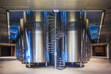 SPA6491AW Spain, Burgos, Gumiel de Izan. Stainless steel storage tanks in Bodegas Portia, a modern Ribera Del Duero winery designed by Norman Foster.