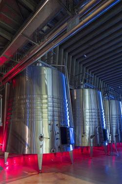 SPA6492AW Spain, Burgos, Gumiel de Izan. Stainless steel fermentation tanks in Bodegas Portia, a modern Ribera Del Duero winery designed by Norman Foster architects.