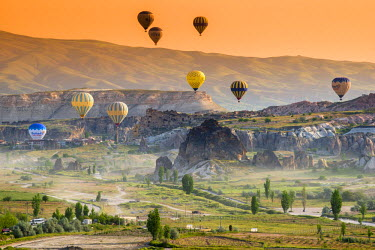 TUR0379AW Sunrise landscape with hot air balloons, Goreme, Cappadocia, Turkey