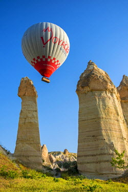 TUR0388AW Scenic fairy chimneys landscape with hot air balloon, Goreme, Cappadocia, Turkey