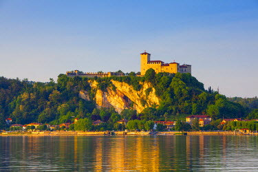 IT04392 The imposing La Rocca fortress viewd from Arona at sunset, Lake Maggiore, Piedmont, Italy