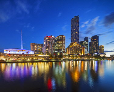 AUS2018 Melbourne Southbank skyline, Eureka Tower, the 2nd tallest building in Australia and Hamer Hall over the Yarra River at twilight, viewed from Princes Bridge, Melbourne, Victoria, Australia.