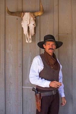 USA10125AW USA, Arizona, Tombstone, Portrait of a man outside a Saloon. MR