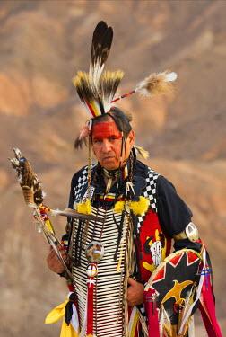 USA10169AW USA, California, Lakota indian Jim Yellowhawk standin in full regalia at Zabriskie point in Death Valley