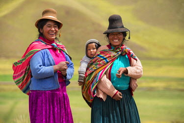 PER33847AW South America, Peru, two native indian women with a child along the Highway from Puno to Cusco