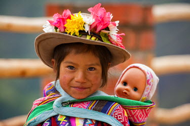 PER33874AW South America, Andes, Peru, Cusco, native girl and her doll