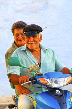 GR10164 Man And Woman On Motorbike, Symi, Dodecanese, Greek Islands, Greece, Europe