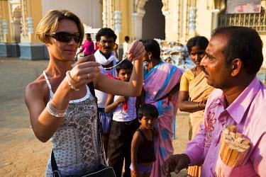 HMS0375784 India, Karnataka State, Mysore, tourist selling handicraft